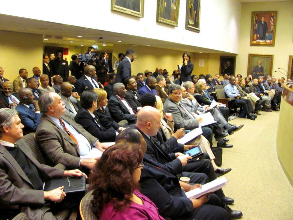 An unusually large audience attended the BOE meeting today, sitting beneath the portraits of past Baltimore mayors. (Photo by Mark Reutter)