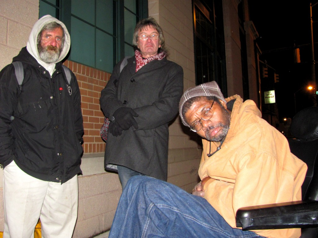 James Rubino, Edward Zentgraf and Melvin Boyd (in wheelchair) wait to return to the shelter. (Photo by Mark Reutter)