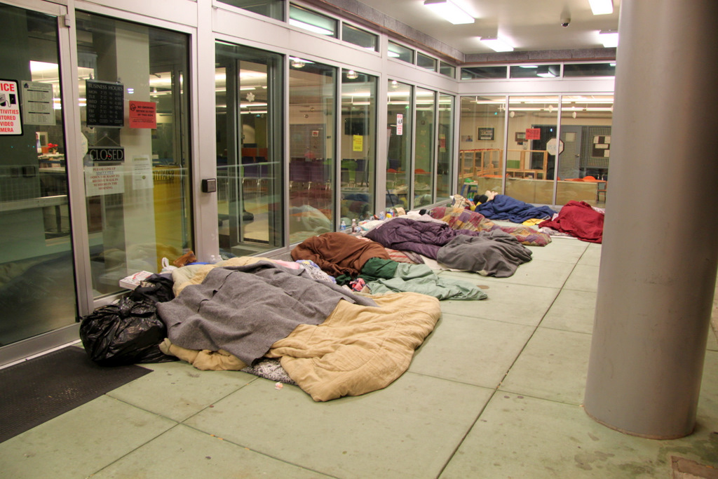 Recently, an eight-months pregnant woman was among the people sleeping outside this Baltimore homeless services clinic. (Photo by Fern Shen)