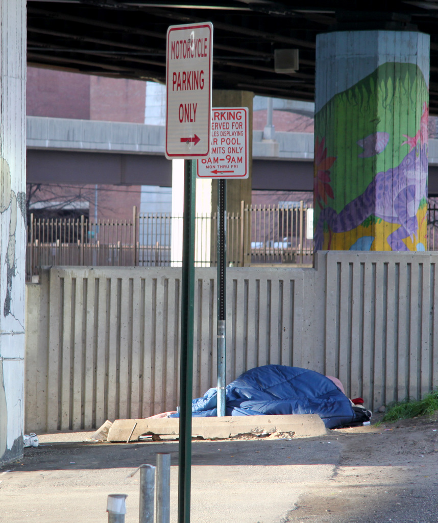 There are people sleeping outside all over Baltimore, including this person under the JFX across the street from Health Care for the Homeless. (Photo by Fern Shen)