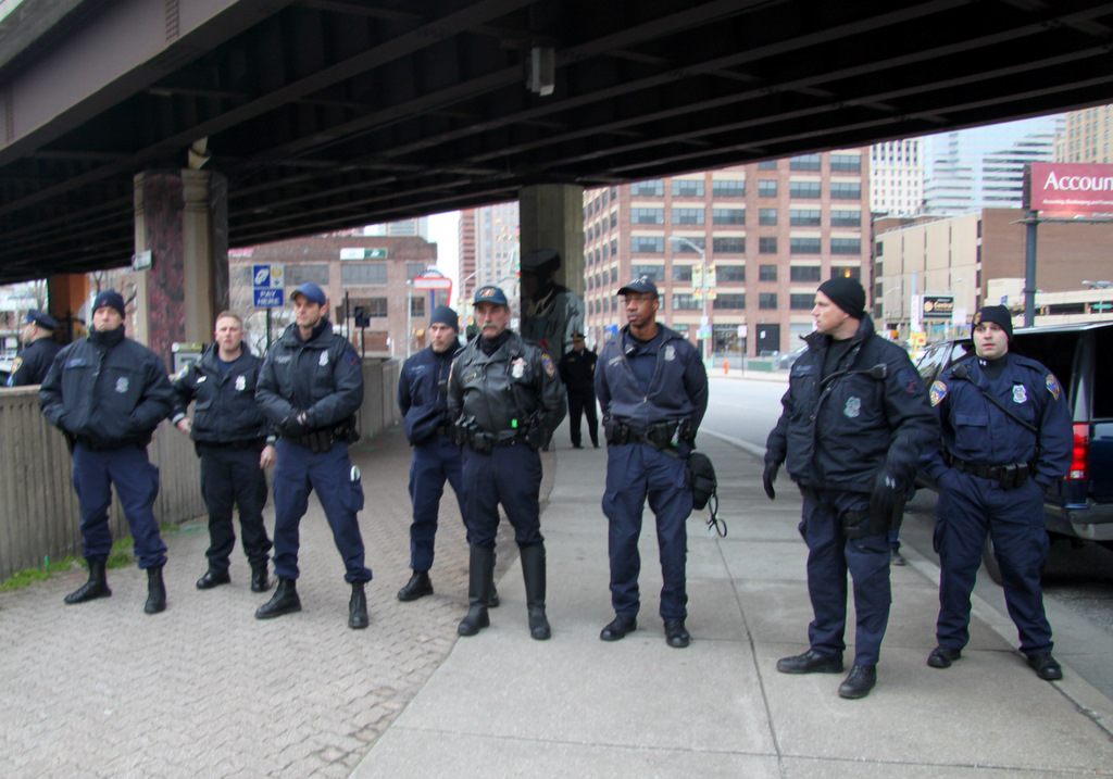 Police on Holliday Street, positioned between protesters and City Hall. (Photo by Fern Shen)