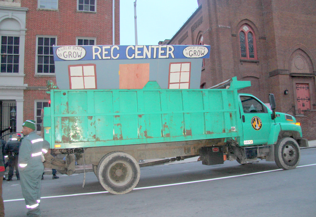 Rec Center sign, after police seized it from protesters, being removed by city workers. (Photo by Fern Shen)