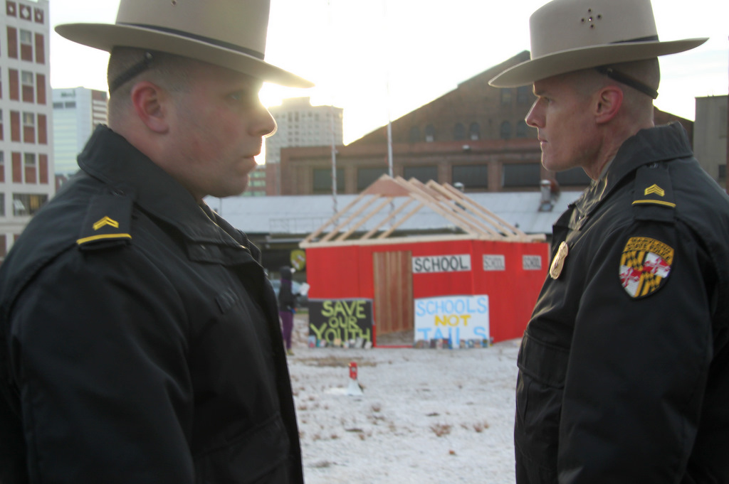 Maryland State Troopers at site of planned youth jail in Baltimore, hours before government crews tore down symbolic
