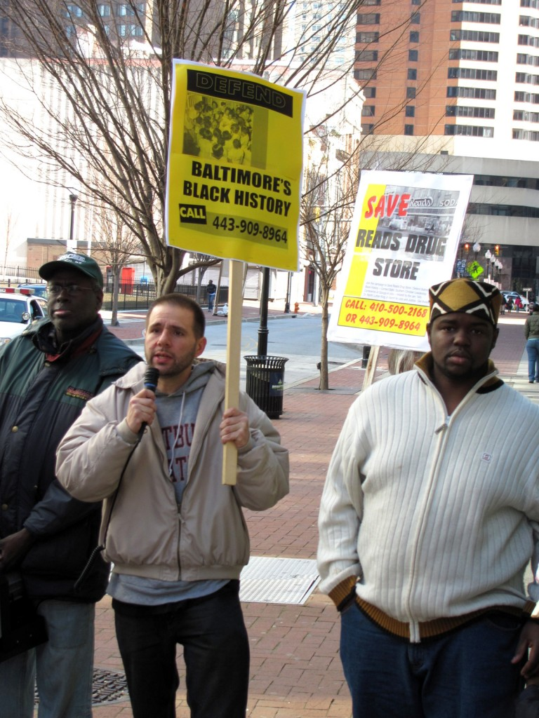 Stephen Ceci, a student at UMBC, speaks at the rally. To his right is Rev. C.D. Witherspoon. (Photo by Mark Reutter)