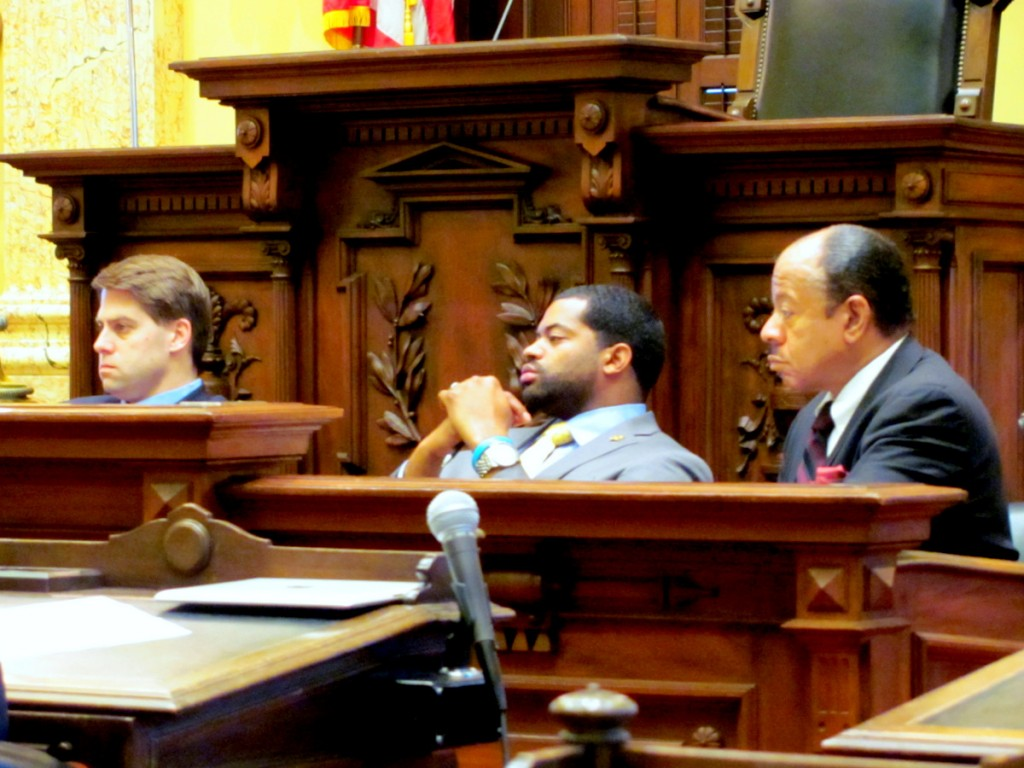 Councilmen Bill Cole, Nick Mosby and Pete Welch listen to Black during today's hearing. (Photo by Mark Reutter)