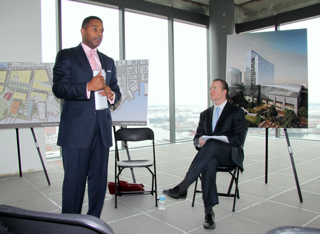 Calvin Butler, of Exelon and Michael Beatty, of Harbor East Development Group speak to reporters about Exelon's new building. (Photo by Fern Shen)