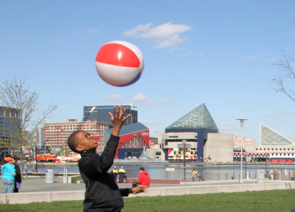 Playing near the Inner Harbor Visitor Center, before the march. (Photo by Fern Shen)