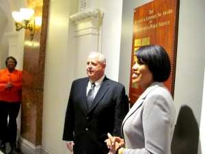 Heinbuch poses beside the award plaque with Mayor Rawlings-Blake. (Photo by Mark Reutter)