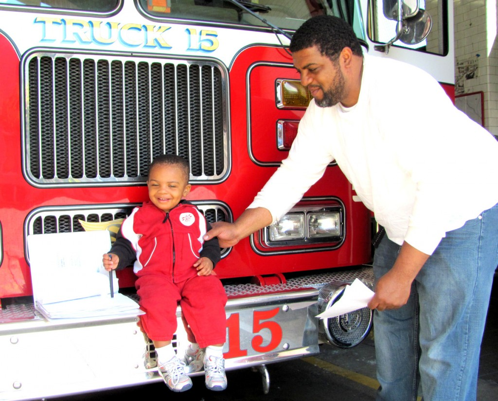 Anton Manning, age 16 months, loves fire trucks and was invited for an inspection of Truck 15 last Friday. Asked his opinion of the proposed closing of the company, Anton Manning Sr. said,