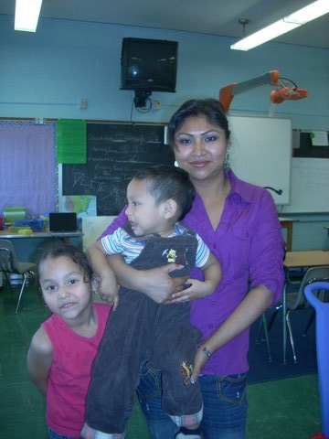 purple shirt:  Irais Vasquez, shown here with her children Layla and Ian, was a top student in the English-language class sponsored by the Child First Authority.