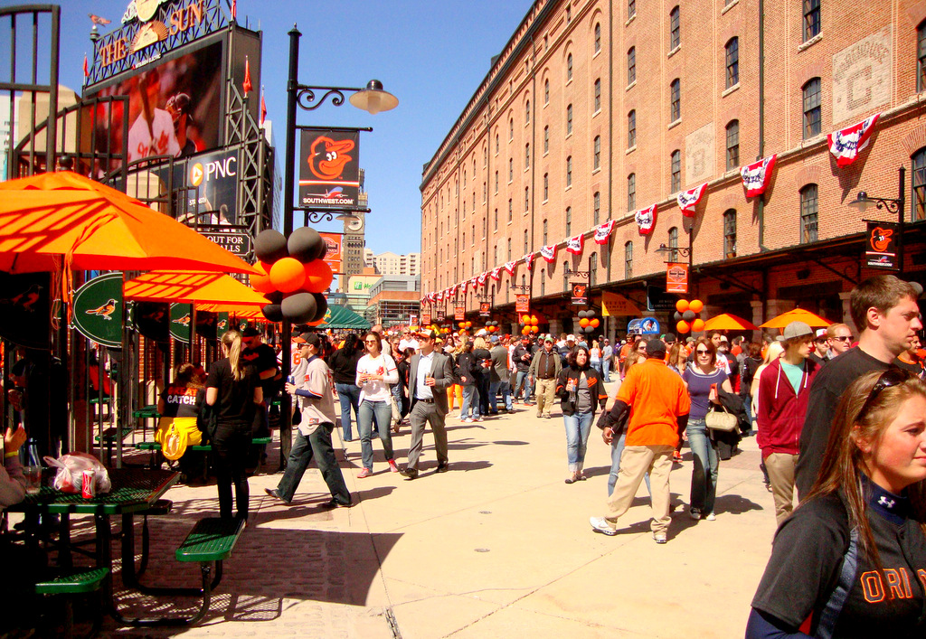 On Eutaw Street, fans sampled new fare including Mac 'n Cheese Dogs and bacon-on-a-stick. (Photo by Dean Bartoli Smith