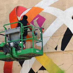 Vladimir Manzhos, part of Ukrainian duo Interesni Koski, painting a mural