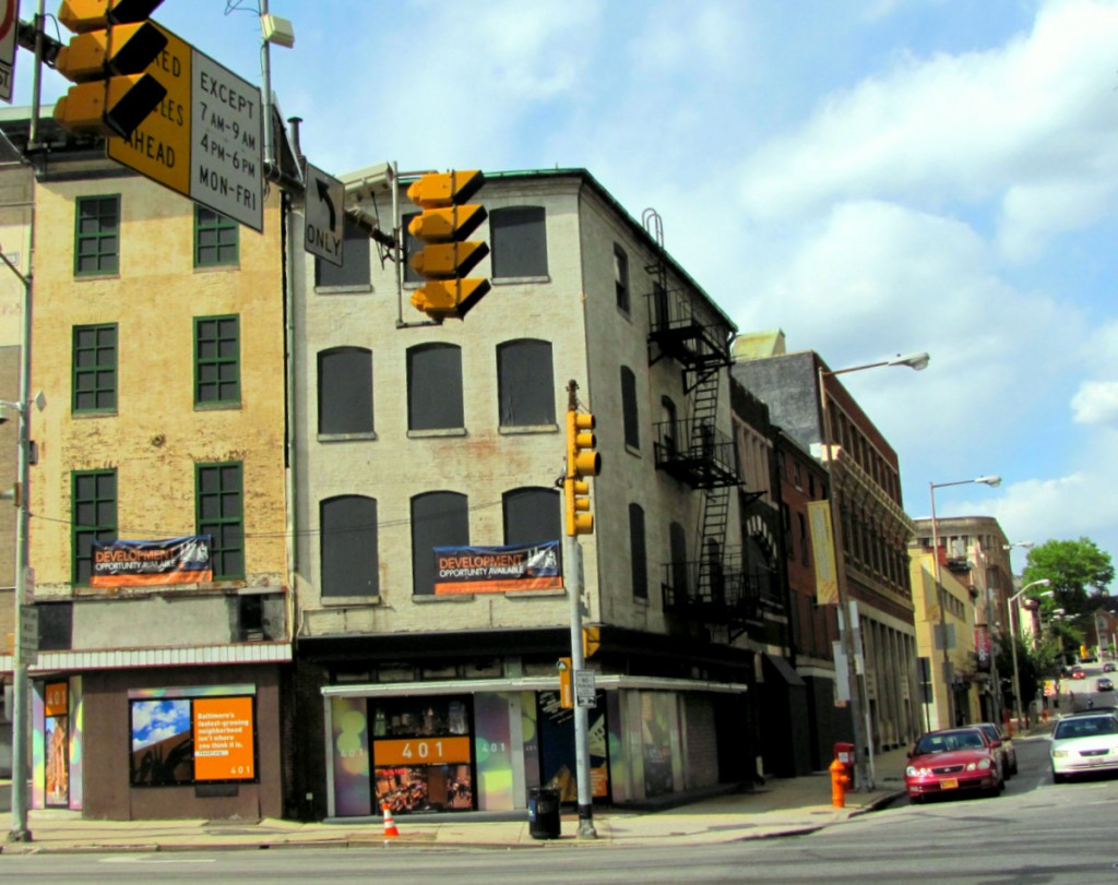 Looking north at Fayette, the four properties on Liberty Street would be demolished, while the yellow building would be retained. (Photo by Mark Reutter)