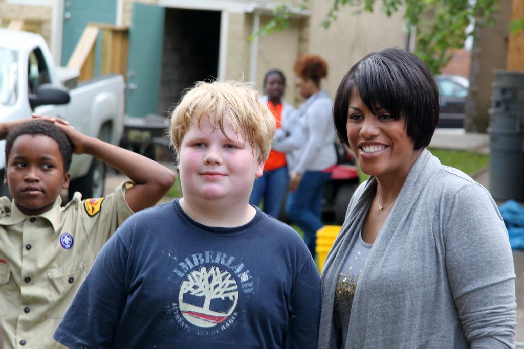 Volunteer Zion Gibson poses with Mayor Rawlings-Blake. (Photo by Louie Krauss)