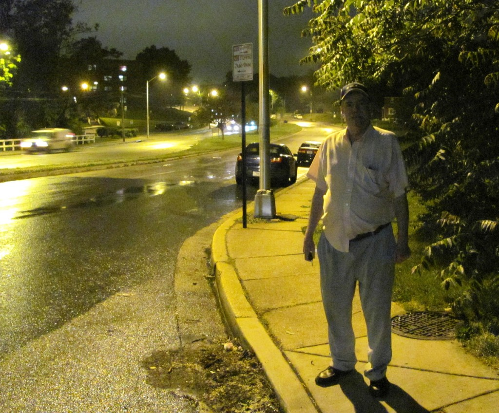Now that's better: Curran stands near a sodium light shining on Hillen Rd. (Photo by Mark Reutter, with no touchups)