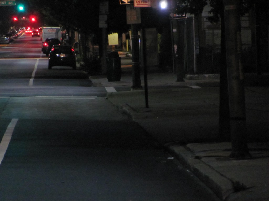 The 1900 block of Charles Street last Wednesday night, looking north along a stretch of new LED street lights. Below the same block, looking south on Charles toward North Ave. (Photos by Mark Reutter)