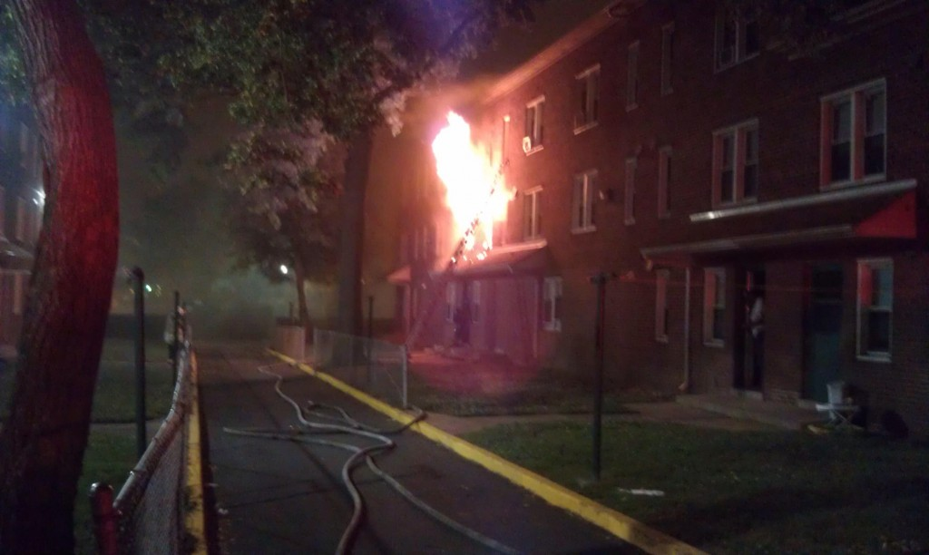 Another view of the flames at the rear of the house. Firefighters had to carry ladders and hoses more than a block to the scene. (Photo by Nick Eid)