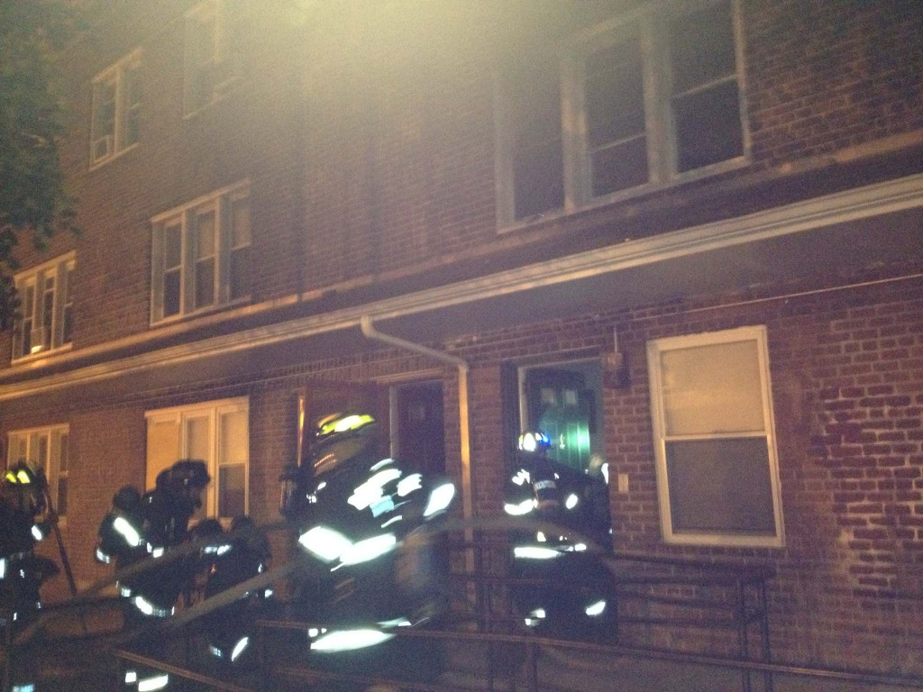Firefighters enter from the front of the building to search for the trapped children. (Photo by Nick Eid)