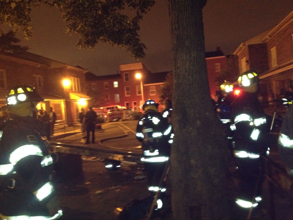 Scene on Lexington Street shortly after the firefighters rescued the three children from the building. (Photo by Nick Eid)