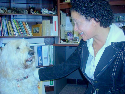 Principal Deborah F. Sharp greets Bella in her office at Yorkwood Elementary School (Photo by Bess Keller)