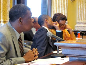 Councilmen Warren Branch, Brandon Scott and Sharon Green Middleton confer before calling a halt to today's hearing. (Photo by Mark Reutter)