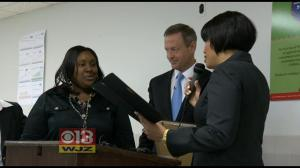 Social worker Dana Hayes was awarded a plaque for bravery by Gov. O'Malley and Mayor Rawlings-Blake in a ceremony yesterday. (WJZ-Channel 13)