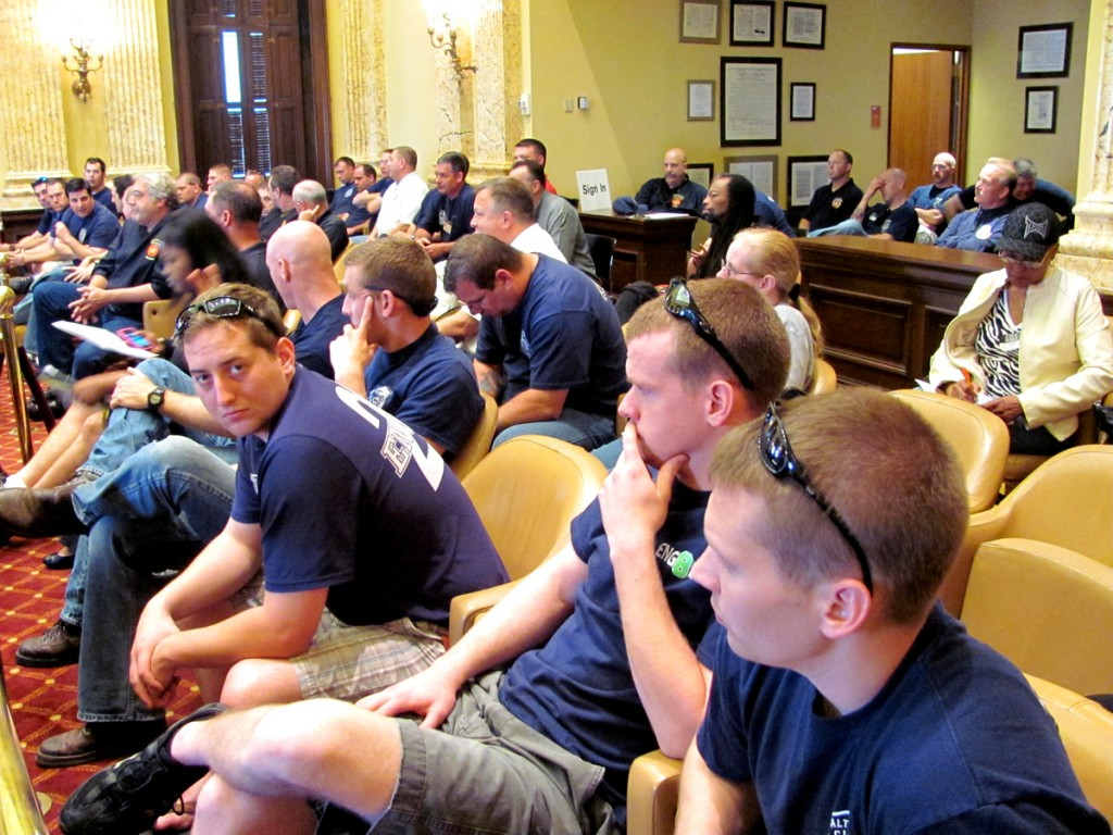 About 50 firefighters attended today's abbreviated Council hearing. (Photo by Mark Reutter)