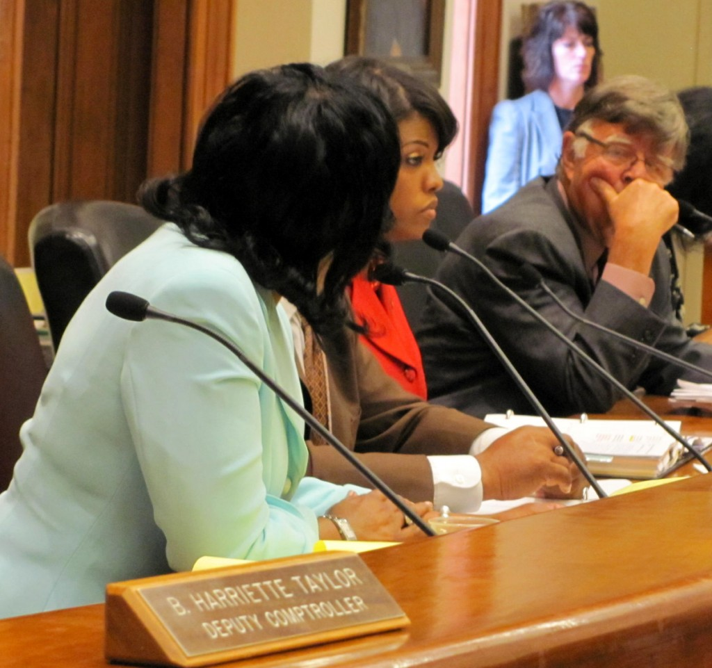 Mayor Rawlings-Blake listens to Pratt's criticism at the Board of Estimates meeting. At far right is City Solicitor George Nilson. (Photo by Mark Reutter)