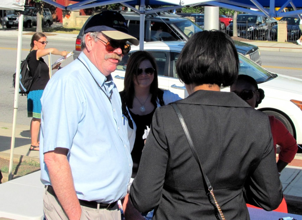 City Councilman Bob Curran speaking with the mayor, who shied away from photographs. (Photo by Mark Reutter)