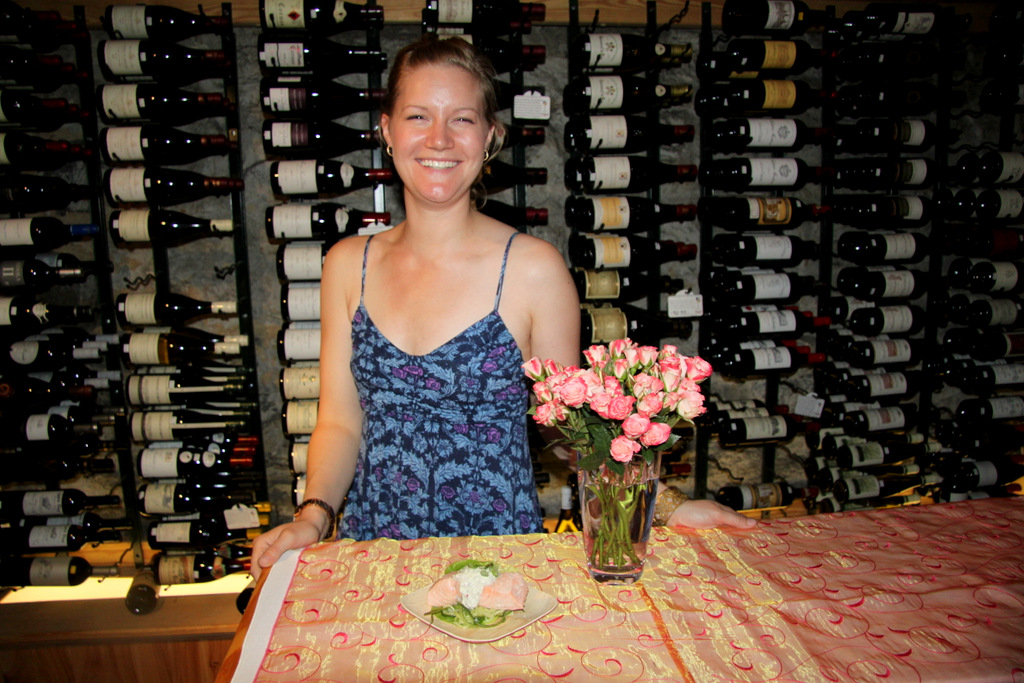 Ready for her rose: the Brew's Meredith Mitchell with pink roses and pink salmon. (Photo by Fern Shen)