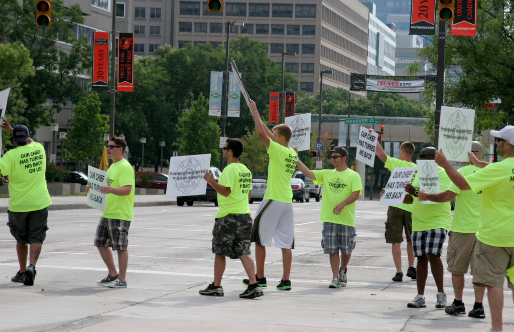 Baltimore firefighters protesting company closures briefly blocked Pratt Street today. (Photo by Carol Ott.)