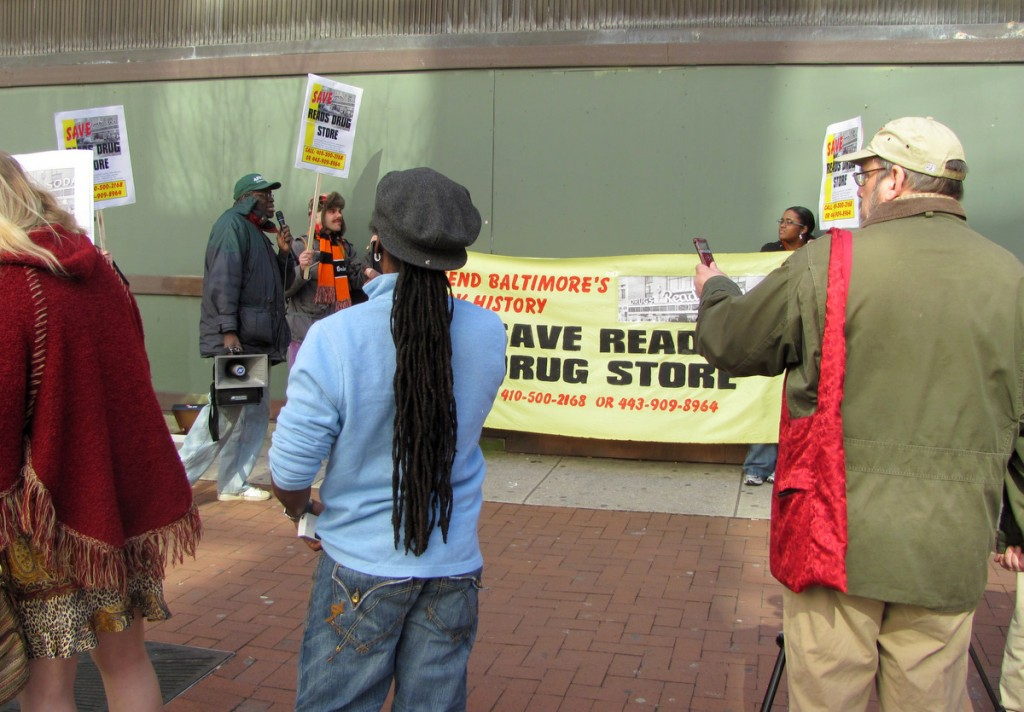 Protesters call for the preservation of the former Read's Drug Store on Superblock last February. The developer has pledged to retain the building's outer facade. (Photo by Mark Reutter)