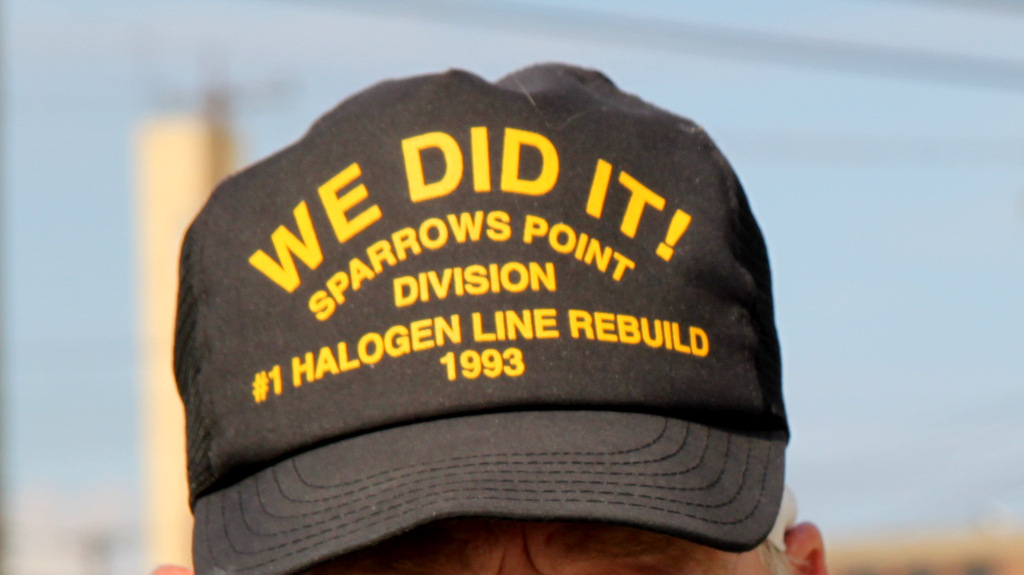 A retiree proudly wears a cap honoring the rebuilding of the Sparrows Point halogen production facility in 1993. (Photo by Fern Shen)