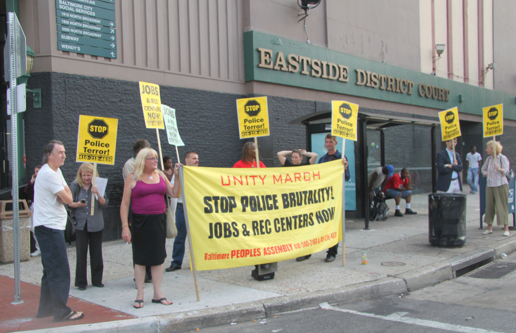 Demonstratpors protested outside District Court in Baltimore about police brutality and the arrest of Sharon Black and Cortly Witherspoon. (Photo by Fern Shen)