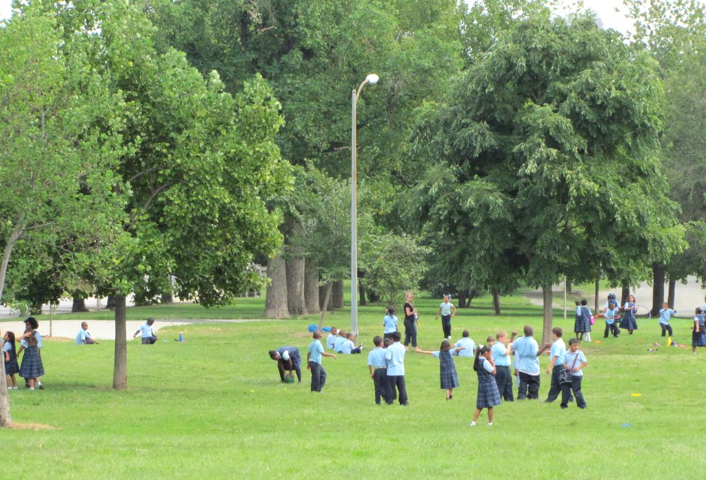 Children at the Patterson Park Charter School play in the park during recess yesterday. (Photo by Mark Reutter)