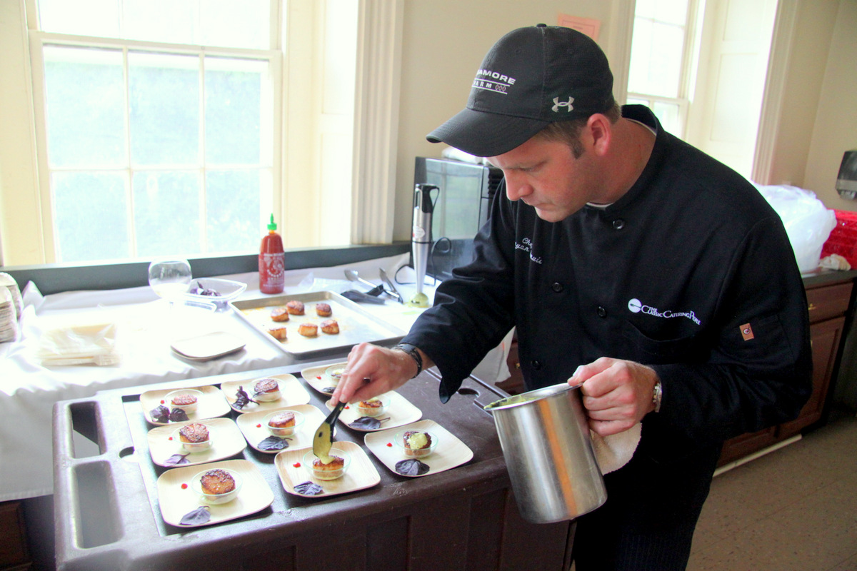 Chef Bryan Davis, of The Classic Catering People, prepares Tandoori-rubbed Scallops. (Photo by Fern Shen)