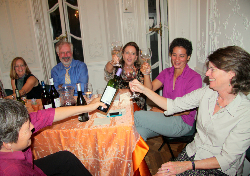 Tasters raise a glass in thanks to Cylburn's Nancy Hill for making the event happen. (Photo by Fern Shen)