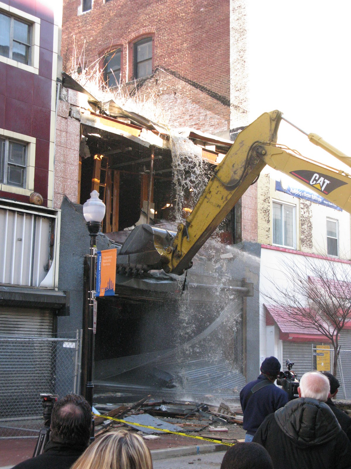 Officials summoned the media to watch a building get demolished in the Weinberg block, near the Superblock. (Photo by Klaus Philipsen)