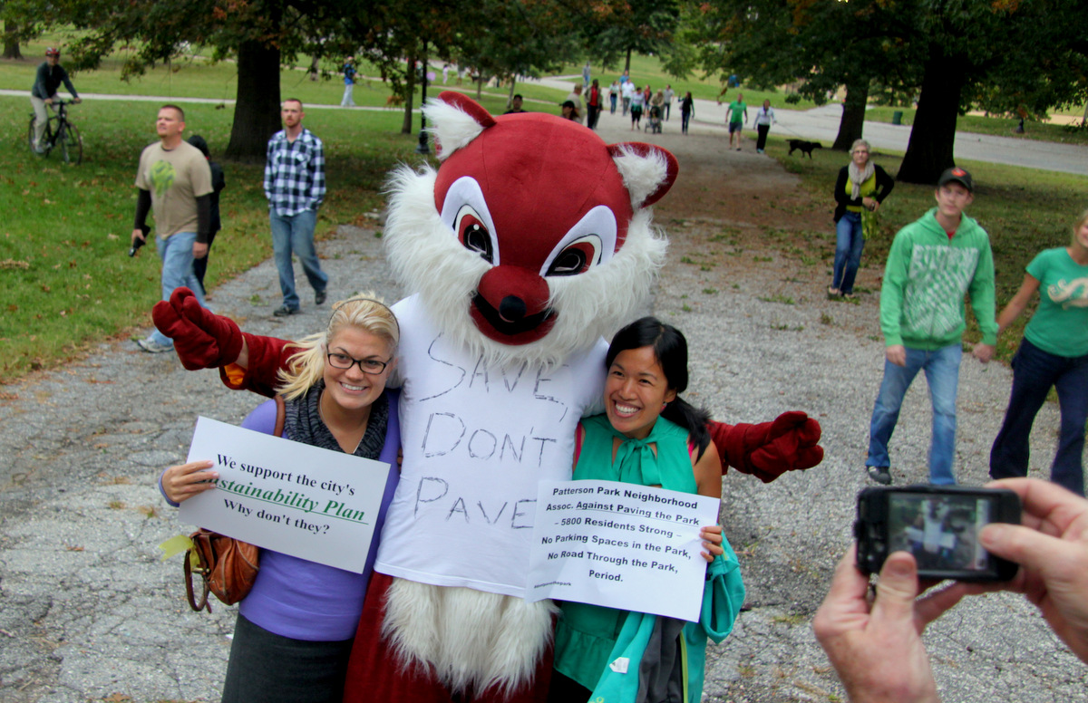 Bicyclists, pedestrians, even a giant chipmunk headed in to the rec center for the meeting. (Photo Fern Shen)