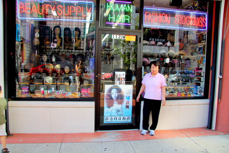 Young Cho and her husband have owned this building on W. Lexington since 1982. (Photo by Fern Shen)