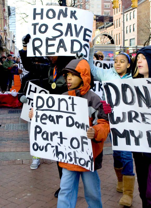 Schoolchildren protest the demolition of the Read's Drugstore building.