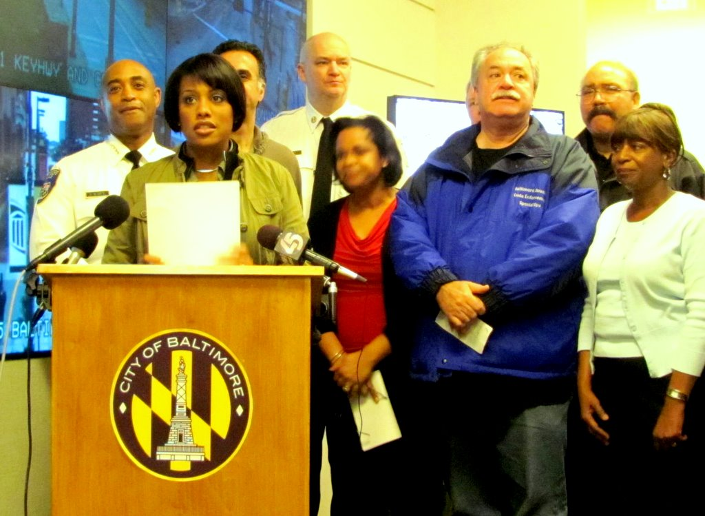 Mayor Rawlings-Blake briefs the press on the hurricane's aftermath with her command staff, including new police commissioner, Batts, to her left. (Photo by Mark Reutter)