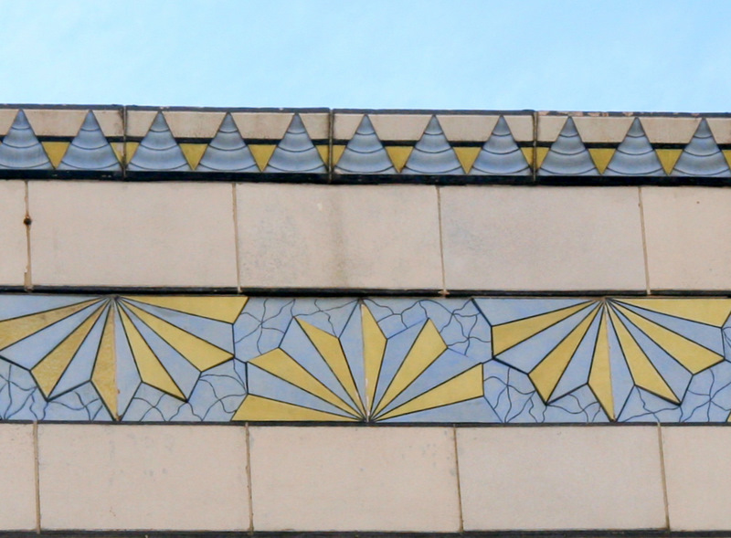 Detail from the top of the McCrory's Building, on Lexington Street. (Photo by Fern Shen)