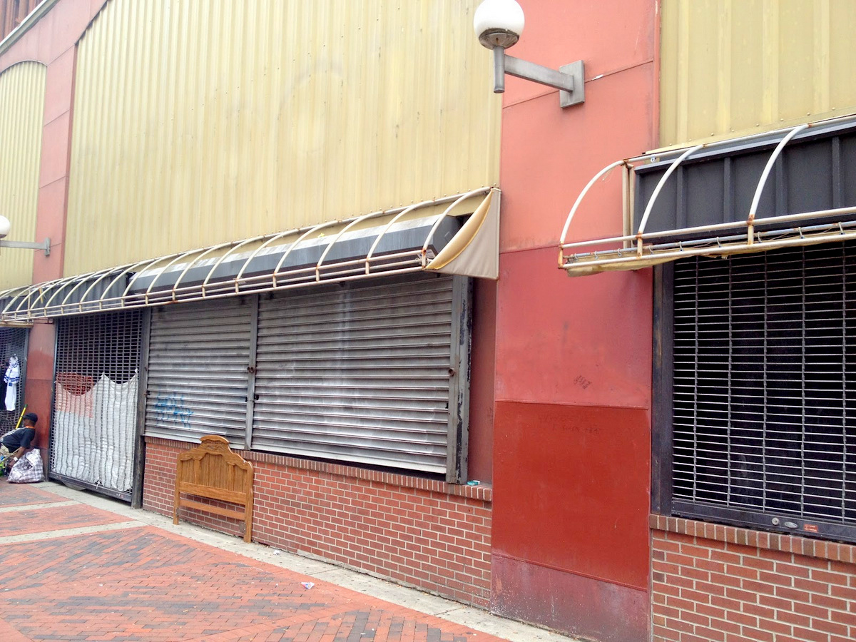 Shuttered stores facing Howard Street are . . .