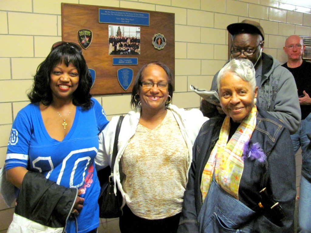 Tricia Brissett, Lillian Campbell and Gwen Patillo (l-r) are all smiles as they wait in line to vote at the Public Training Center today. (Photo by Mark Reutter)