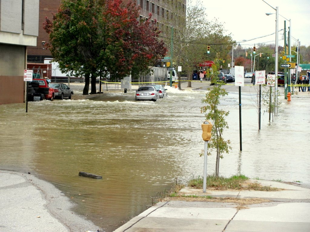 The scene on 20th street where water from the broken main has backed up toward St. Paul and north to 21st Streets. The water flooded a vacant building and several parking lots. (Photo by Mark Reutter)