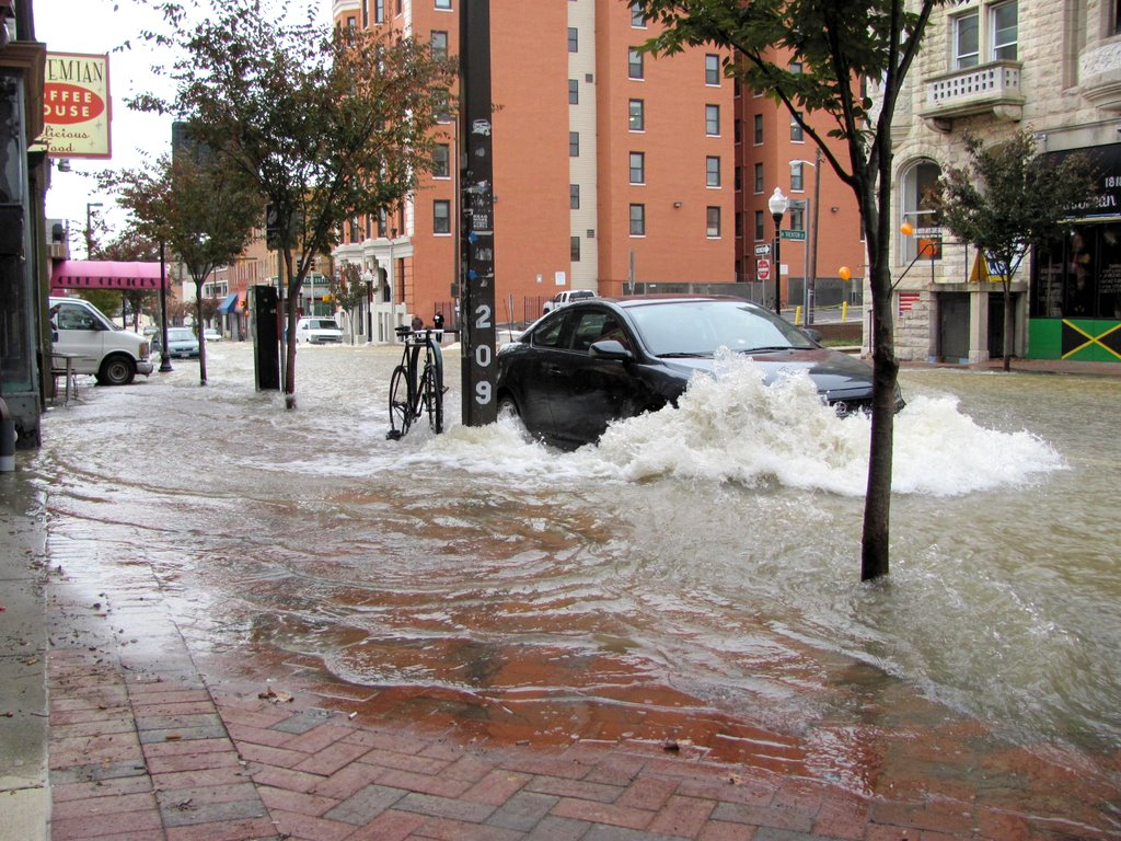 Rapids form around a parked car in the 1800 block of North Charles next to the Bohemian Cafe. This picture are taken at 9 .a.m. (Photo by Mark Reutter)