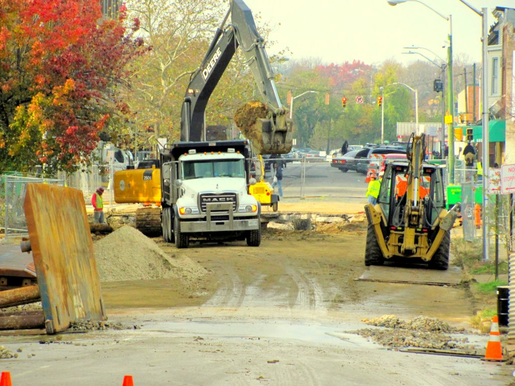 Fifteen blocks from the Madison Street break, workers this morning clear debris from the broken water main at 20th and Charles street, which is expected to take several weeks to repair. (Photo by Mark Reutter)