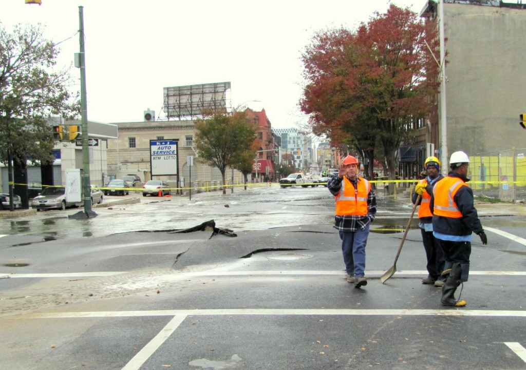 Ground zero of the water main break was at 20th and Charles, with the pavement heaved up from the pressure of the released water. (Photo by Mark Reutter)