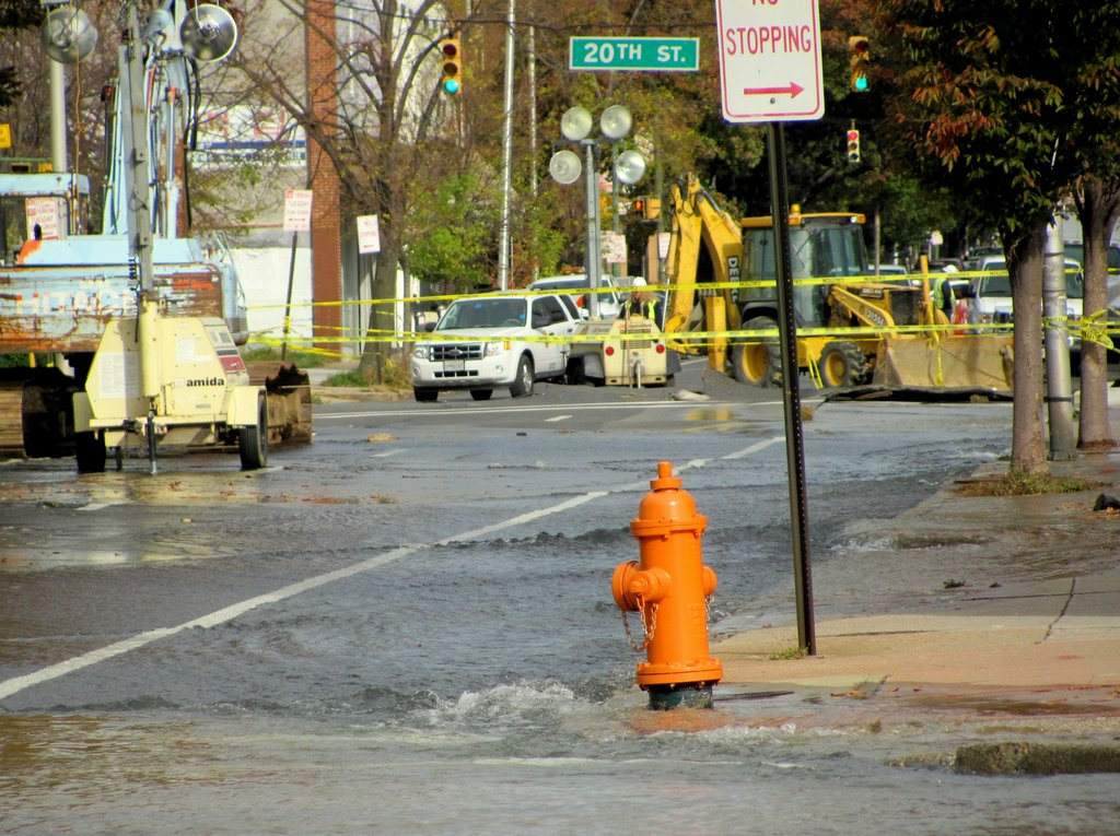 A steady flow of water runs down Charles Street to closed North Avenue this morning. (Photo by Mark Reutter)